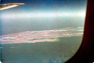 Feb 8, 1979, mid-morning. Window picture of an atoll somewhere in the Indian Ocean off the west coast of Australia. MCS, part of the 9M-MCS call-sign of our Malaysian Airline System's Boeing 707-300 aircraft was clearly visible on the wing.