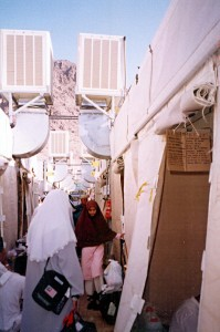 Sun March 19, 2000 (13 Dzulhijjah 1420). My other half, walking towards her friend, in our Maktab 82 camp in Mina. The tents' air-conditioning units could be clearly seen above our heads.