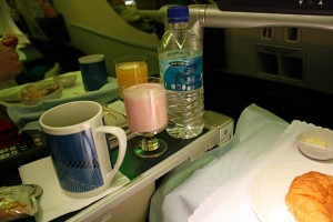 Yoghurt drink, black tea and mineral water to go with breakfast