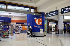 One of the first images in Sydney airport arrival - a Guardian pharmacy