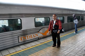 Me beside one of the Red Service carriages at Sydney Central Station