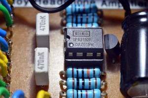 Close up of my CMOY headphone amplifier's Op-Amp IC, resistors, capacitors and voltage splitter IC