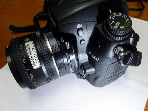 DSLR with standard 50mm lens fitted with extension tube, ready for some close up photography
