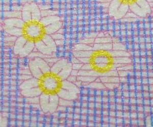 Three cherry blossoms on a currency note. The actual size of the flowers on the note was very small, and the yellow rings were nearly invisible under normal house lighting.