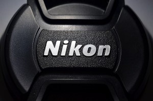 The lens cap logo, with slightly different light angle.